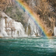 Rainbow on Krka waterfall - Stock Photo