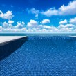 Infinite swimming pool with ocein background — Stock Photo #33253719