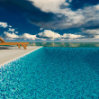Infinite swimming pool with ocean in background — Stock Photo