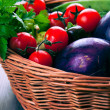 Basket with fresh organic vegetables — Stock Photo