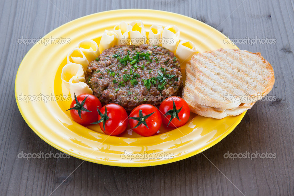 Steak Tartare with toast, butter and tomato — Stock Photo © tomisl ...