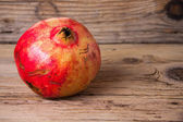 Pomegranate on the old wood background — Stock Photo