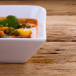 Homemade vegetable soup on wooden board close up — Stock Photo