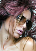 Woman with sunglasses and beautiful burgundy hair — Stock Photo
