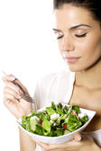 Happy woman eating healthy vegetable salad — Stock Photo
