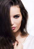 Beauty woman face with haircut. Brunette.Brown hair. — Stok fotoğraf