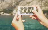 Ship through lens of a mobile phone — Stock Photo
