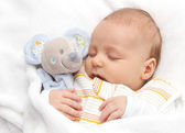Baby sleeping in bed — Stock Photo
