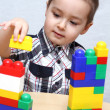 Child builds a tower — Stock Photo