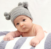 Baby in gray hat — Stock Photo