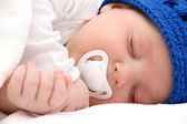 Sleeping baby with pacifier closeup — Stock Photo