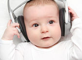 Baby listening music on back — Stock Photo