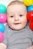 Happy baby with toys — Stock Photo