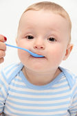 Beautiful baby eating — Stock Photo