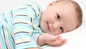 Little baby lying in bed and look at the camera — Stock Photo