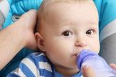 Baby drinks baby milk — Stock Photo