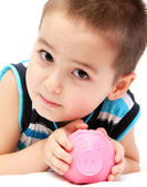 Child holding piggy bank — Stock Photo