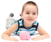 Happy child with piggy bank — Fotografia Stock