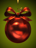 Red christmas ball isolated on green background — Stock Photo