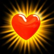 Red heart in the rays of light — Foto de Stock
