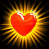 Red heart in the rays of light — Stock Photo