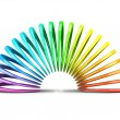 Multicolored slinky isolated on white background - Stock Photo