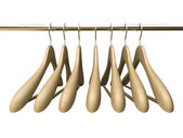 Seven wood hangers isolated on the white background — Stock Photo