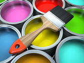 Banks of multicolored paint and brush — Stock Photo