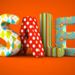 Sale word fabric on orange  background — Stock Photo