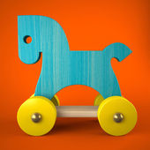 Blue wood horse toy on red background — Stok fotoğraf