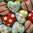 Patterned fabric hearts on dark background — Stock Photo