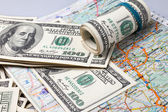 Dollars on a geographical map of Ukraine — Stock Photo