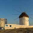 Sunset at White windmill on the island of Mykonos — Stock Photo