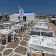 Stock Photo: White church and restaurant in Naoustown, Paros island