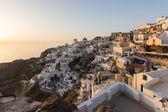 Západ slunce ve městě oia na ostrově santorini — Stock fotografie
