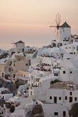 Zonsondergang in de stad van oia, santorini — Stockfoto