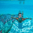 Underwater view of a woman swimming in the swimming pool — Stock Photo