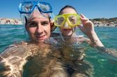 Lovely couple enjoying snorkeling during their vacation — Stock Photo