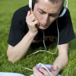 Man listening to the music with white headphones — Stock Photo