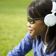 Black woman listening to the music with white headphones  — Stock Photo