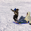 Mother and Son Sledding down the Hill — Stock Photo #2663523