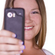 Woman taking pictures from her cell phone — Stock Photo #4118617