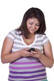 красивая девушка texting на белый bakground — Стоковое фото
