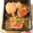 Roast duck legs with caraway and onion - Stock Photo