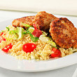 Veggie burgers with couscous - Stock Photo
