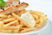 Pan fried pork chop with fries — Stock Photo