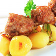 Meatball skewer and potatoes - Stock Photo