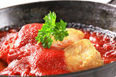 Pan fried fish fillets with tomato sauce — Stock Photo
