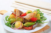 Fish skewer with potato side dish — Stock Photo