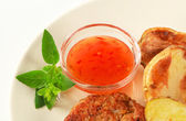 Vegetable patty with potatoes and spicy dip — Stock Photo
